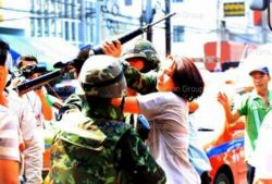 thailand-woman_stealing_rifle_from_soldier.jpg
